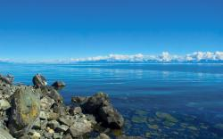 3840x2400 Wallpaper stones, lake, siberia, baikal, water, transparent, clouds