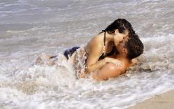 Beach couple kiss