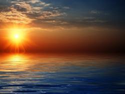 Right click to download Beautiful Sun Rise Over Sea Wallpaper