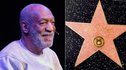 (L) Bill Cosby performs at the Maxwell C. King Center for the Performing
