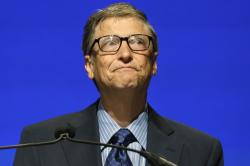 Microsoft chairman Bill Gates chokes up as he end his remarks at the company's annual shareholders meeting Tuesday, Nov. 19, 2013, in Redmond, Wash.