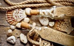 Bottle Shells Rope Old Wood Stones Sand