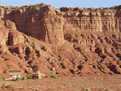 Smoothed Moenkopi beds near Marble Canyon, AZ with nearby residence for scale. THE WESTERN VERMILION CLIFFS