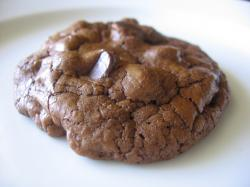 I am a firm believer that in order to have a trully 'Chocolate' cookie it should include melted chocolate in the dough and not just cocoa powder (a ...