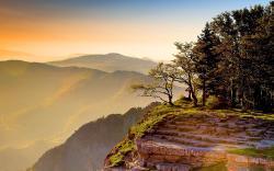 Mountain cliff sunset