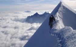 Climber snowy mountain top