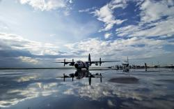 C-130 Hercules aircraft coast guard reflections
