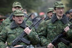 "Members of the first unit of a pro-Russian armed force, dubbed the ""military forces of the autonomous republic of Crimea,"" cheer during their swearing-in ..."
