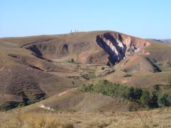Active headward erosion (lavaka) on right, with inactive, largely infilled older examples to left