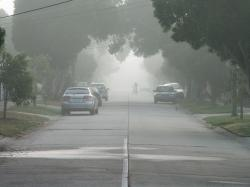 Light fog reduces visibility on a suburban street, rendering the cyclist very hazy at about 200 m (220 yd). The limit of visibility is about 400 m (440 yd), ...