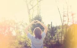 Girl Making Heart With Hand
