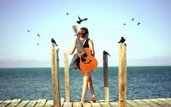 Guitar girl beach