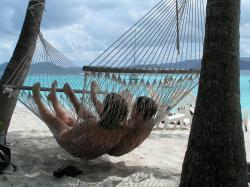A couple in a hammock on the beach