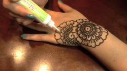 "music from promise phan's ""henna tattoo tutorial"""