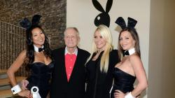 Hugh Hefner and Crystal Harris pose with Playboy Bunnies at the Beverly Hills City Council and