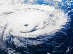 A hurricane is a type of tropical cyclone. It is accompanied by thunderstorms and its winds move in a counterclockwise motion.