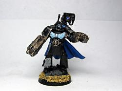 In my tiny head, I have impression that Iron Hands are cold, even for a space marine, conclusion: no warm colors. Black, metal and blue are the main colors ...