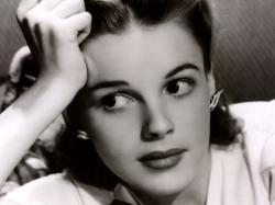 Just like the image of her fragile, unconventional beauty trapped within the glow of a tight spotlight, Judy Garland's life as a performer was surrounded by ...