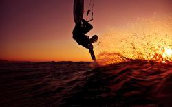 Kitesurfing in sunset
