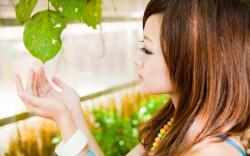 asian mikako zhang kaijie picking leaf drops