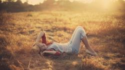 1920x1080 Wallpaper girl, grass, light, sunset, field, hat, mood