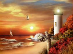 Picture of a sunset and a lighthouse on the beach