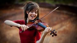 Her name is Lindsey Stirling & she is an incredible violinist famous for her choreographed violin performances! You heard me right!
