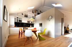The loft features a standalone component in the center of the loft that divides up the otherwise open plan space. The component is used to house all the ...