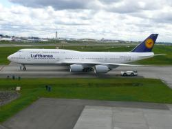 Lufthansa's Boeing 747-8I taxiing next to the Future of Flight. Photo by Chris