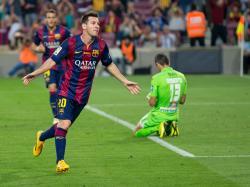 Messi celebrating scoring a goal against Granada CF in October 2014.