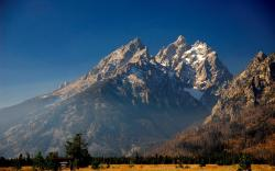 Snowy mountain peaks in spring wallpaper