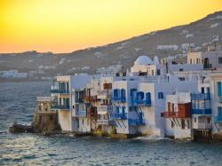 """In Greek mythology Mykonos was the location of the battle between Zeus and the Titans , and the island was named in honor of Apollo's grandson Mykons."