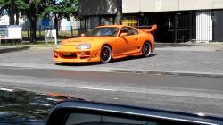 Orange Toyota Supra Driving Out Of Garage