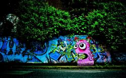 Pink graffiti monster on wall