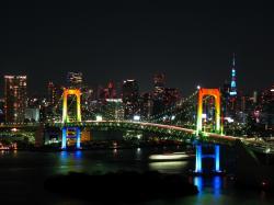 Rainbow colored Rainbow Bridge at night.jpg