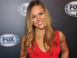 UFC's Ronda Rousey discusses her Sports Illustrated swimsuit appearance - LA Times