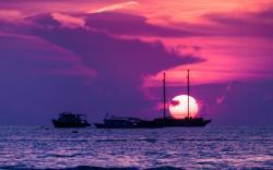 Ships in sunset