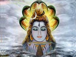 I find this statue of Shiva, nearly submerged in Indian floodwater, somehow very unsettling : creepy