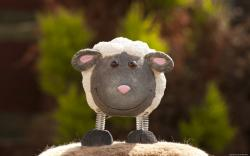 Smiling toy lamb