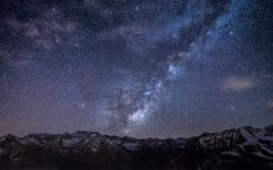 Starry sky above the mountains wallpaper