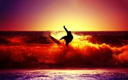 Surfing ocean sunset