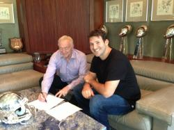 Cowboys QB Tony Romo along with Cowboys Owner Jerry Jones sign Tony's new contract extension on
