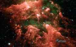 """This is the """"South Pillar"""" region of the star-forming region called the Carina Nebula. Like cracking open a watermelon and finding its seeds, the infrared ..."""