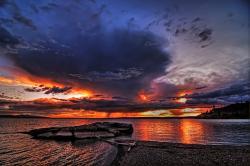The sun casts a dramatic glow over Yellowstone Lake. (photo ©Leon Jenson —