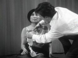 Yoko Ono performing Cut Piece, 1964